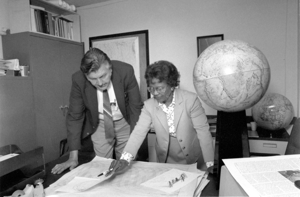 Sam Smith reviews data with Gladys West in 1985 at the Dalhgren Division. (U.S. Navy)